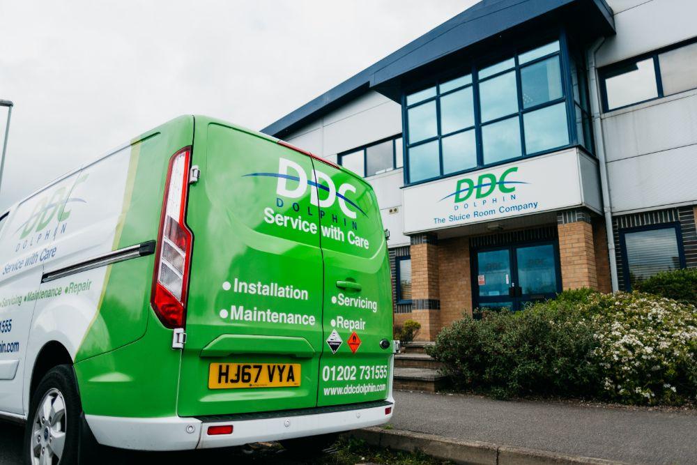 Back Of DDC Dolphin Van In Front Of Office