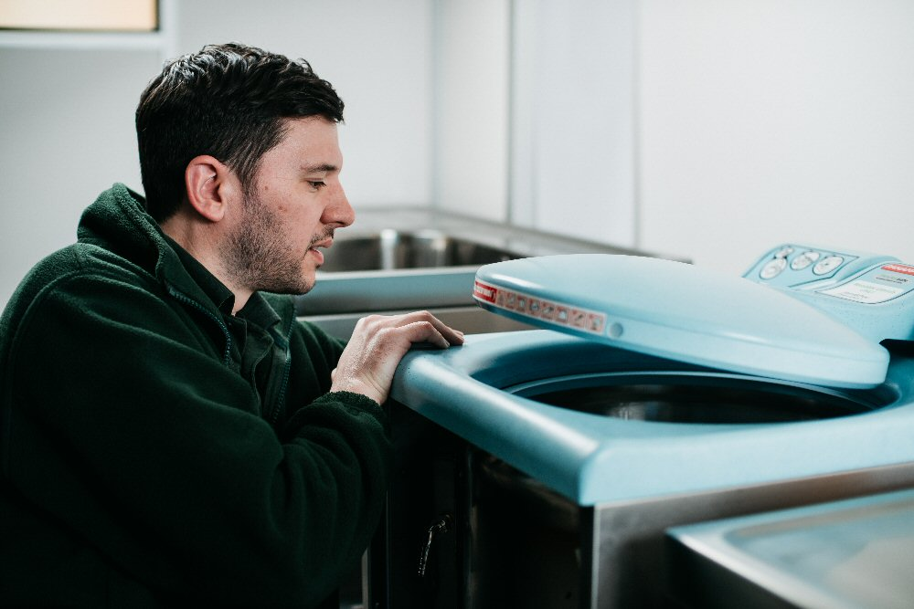 DDC Dolphin Engineer Servicing Bedpan Washer